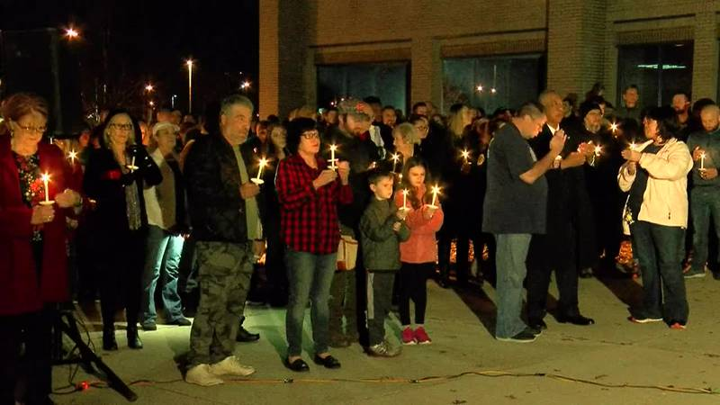 GF Default - Community members and police honor fallen police officer at candle light vigil