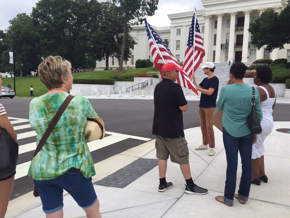 A separate group congregated across the street from the Capitol on Dexter Ave. (Source: WSFA 12)