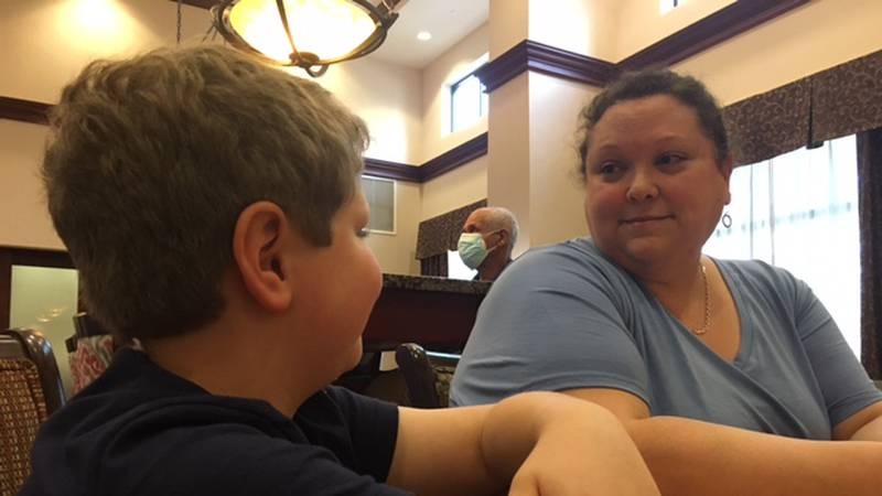 Angelique Russo chats with her son at the Hampton Inn & Suites in Prattville. The family was...