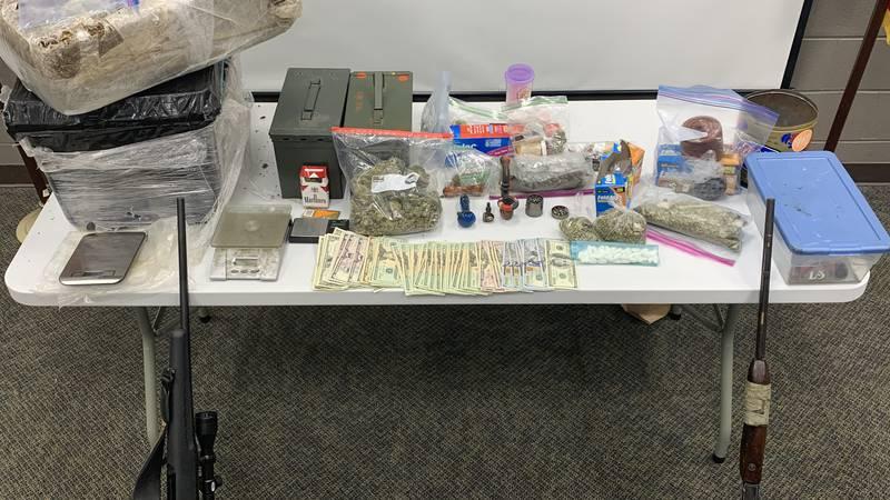 Drugs, guns seized in DeKalb Co. raid
