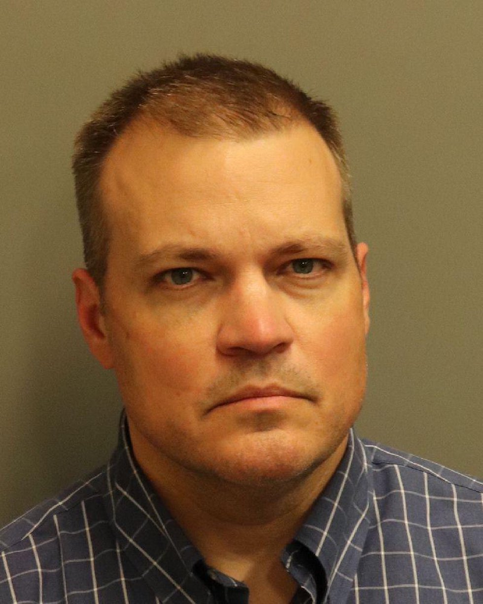 Lee County District Attorney Brandon Hughes' mug shot from the Montgomery County Jail.