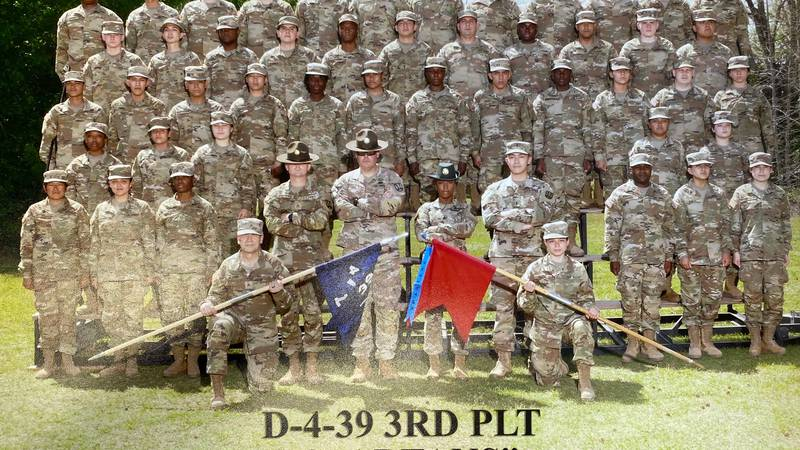 """Sgt. Gary Willford Jr. and the rest of the """"Spartans"""" pose for a class photo after graduating..."""