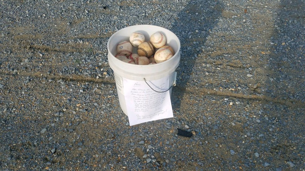 Randy Long left this bucket of baseballs at a batting cage so another family could make...