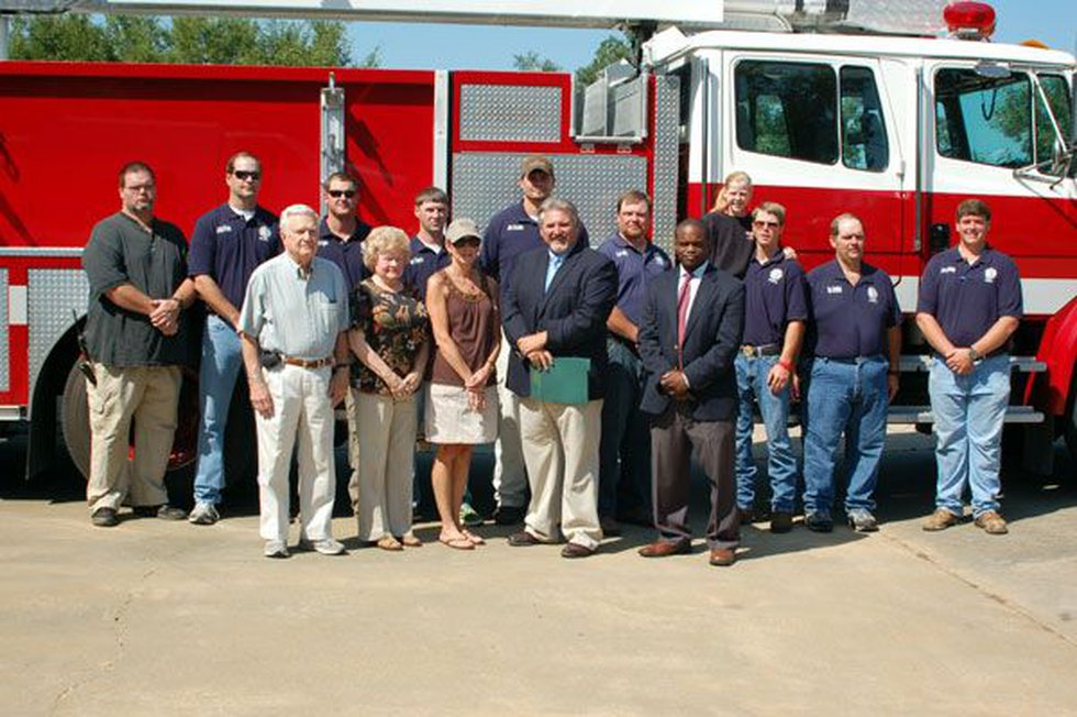 Posing for a photo with the Pine Hill VFD's new tool (Source: Alabama Forestry Commission)