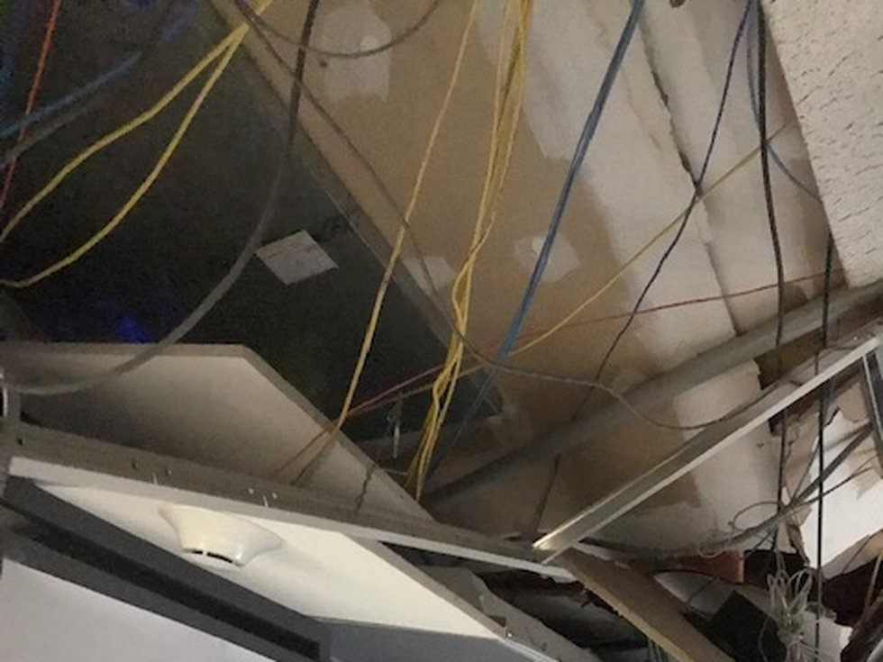 The KPLC-TV studios were damaged when a broadcast tower was toppled during Hurricane Laura...