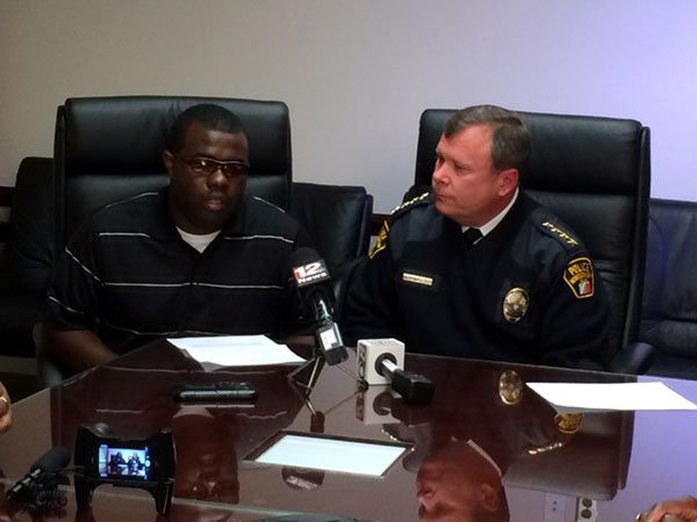 Officer Carlos Rogers (L) and Police Chief Kevin Murphy (R) at a news conference Thursday to...